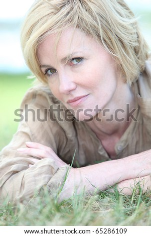 Portrait of a senior woman laid in grass