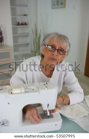 Portrait of a senior woman making some sewing