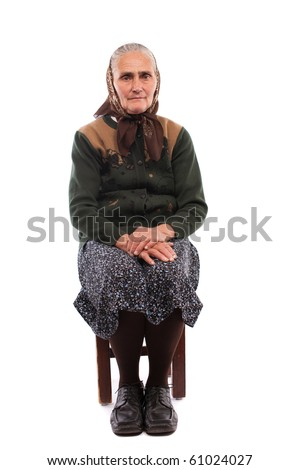Portrait of a senior woman sitting on chair, isolated on white background - stock photo