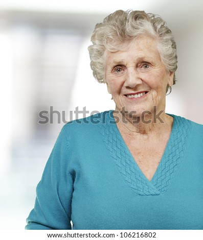 portrait of a senior woman smiling, indoor - stock photo