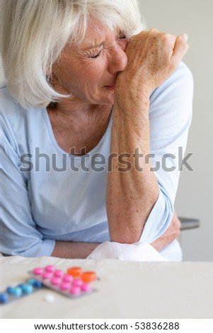 Portrait of a senior woman suffering from bellyaches - stock photo