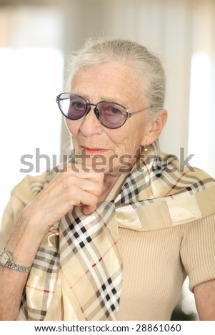 Portrait of a senior woman thinking. Shallow DOF. - stock photo