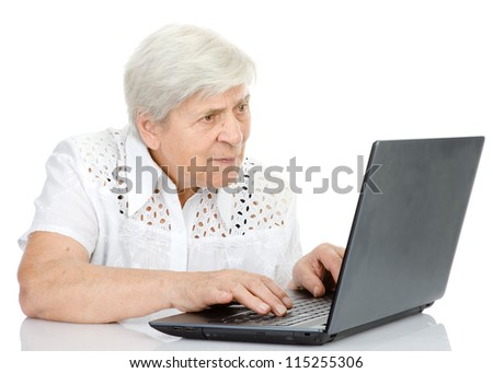 Portrait of a senior woman  using laptop. isolated on white background - stock photo