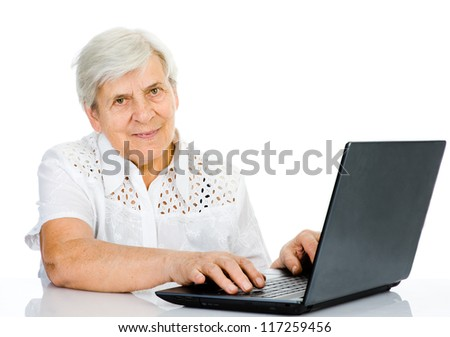 Portrait of a senior woman using laptop. looking at camera. isolated on white background - stock photo