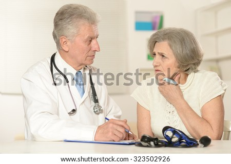 Portrait of a senior woman visiting doctor at hospital