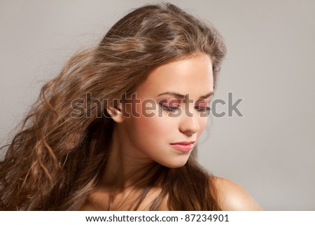 Portrait of a sensual beautiful young girl with tousled brown hair - stock photo