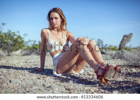 portrait of a sensual brunette girl over desert background with copy space