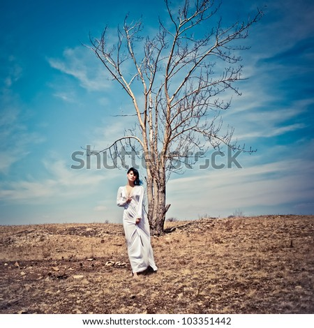 portrait of a sensual girl in the forest - stock photo