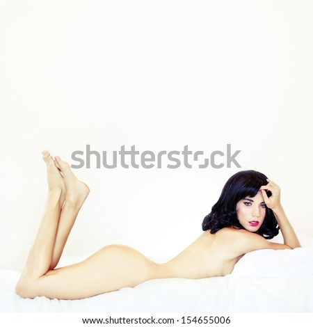 Portrait of a sensual lady in bed - stock photo