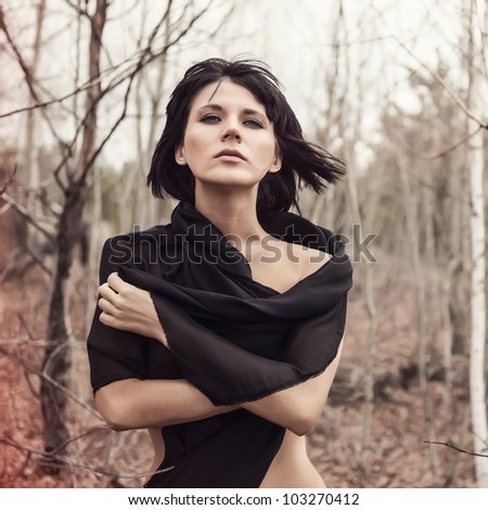 portrait of a sensual woman in the woods - stock photo
