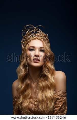 Portrait of a sensual woman with wire crown on head - stock photo