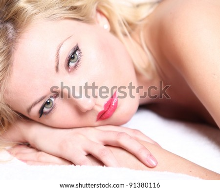 Portrait of a sensual young blond woman - stock photo