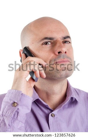 Portrait of a serious bald man looking up while on mobile phone. Expression of disbelief Lilac shirt. Isolated. - stock photo
