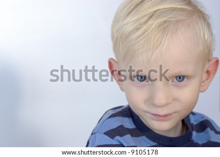 Portrait of A serious boy with blue eyes
