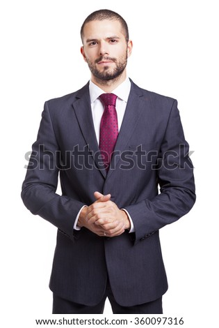 Portrait of a serious businessman, isolated on white background - stock photo