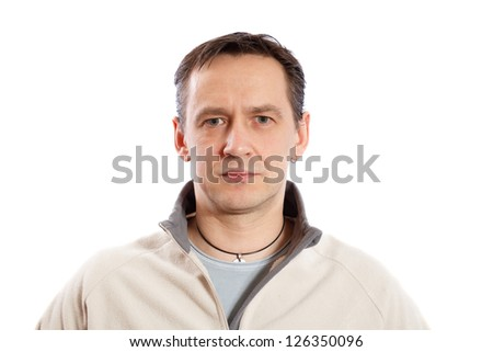 Portrait of a serious man on a white background