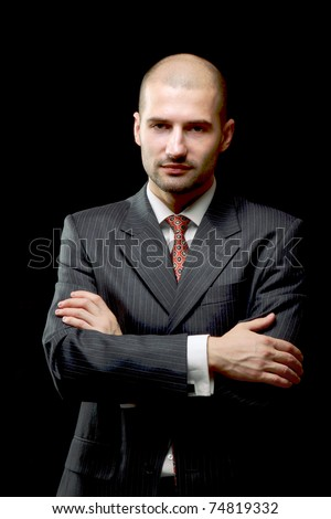 Portrait of a serious man wearing a suit - stock photo