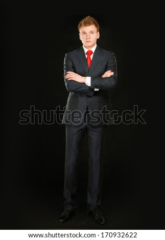 Portrait of a serious man wearing a suit, isolated on white background - stock photo