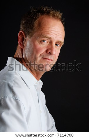 Portrait of a serious middle age businessman - stock photo