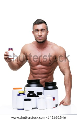Portrait of a serious muscular man with sports nutrition