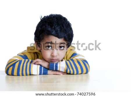 Portrait of a Serious Toddler with face resting on folded hands, Isolated, White - stock photo