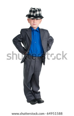 Portrait of a serious young boy with suit and chequered hat over his eyes - stock photo