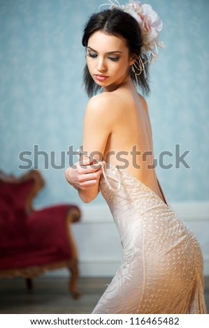 Portrait of a sexy fashion model posing with vintage wedding dress - stock photo