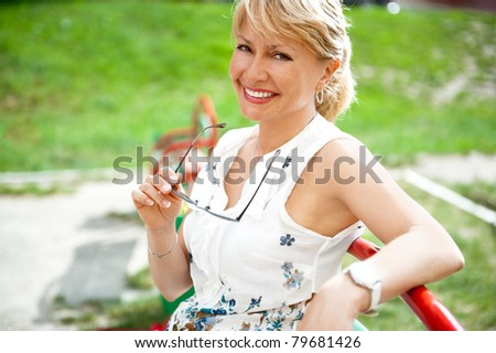 Portrait of a sexy  female smiling in a park - Outdoor - stock photo