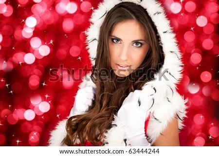 portrait of a sexy santa woman on shiny background - stock photo