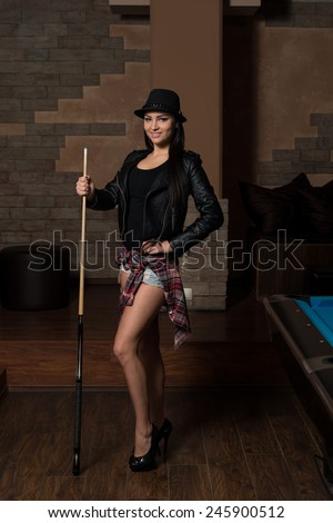 Portrait Of A Sexy Woman Playing Billiards - stock photo