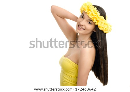Portrait of a sexy woman with wreath of yellow flowers on the head. Beautiful smiling brunette woman wearing a ringlet of flowers. Girl with long straight hair. - stock photo