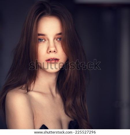 Portrait of a sexy young girl with beautiful curls - stock photo