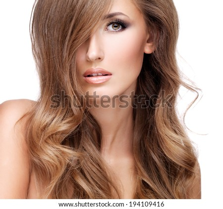 Portrait of a sexy young woman with beautiful long brown hair. Closeup, isolated on white - stock photo