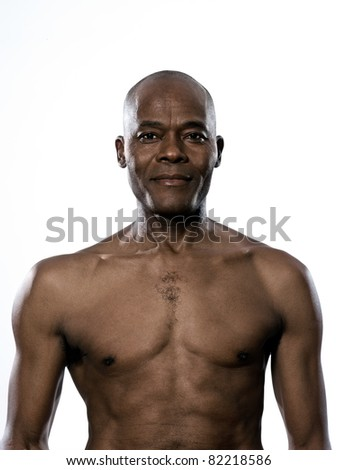 Portrait of a shirtless Afro American man in studio on white isolated background - stock photo
