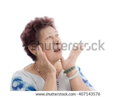 Portrait of a shocked elderly female isolated against white background - stock photo