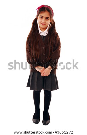 Portrait of a shy schoolgirl isolated on white