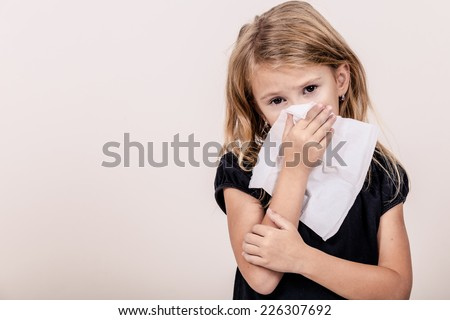 Portrait of a sick little girl at home - stock photo