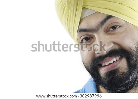 Portrait of a Sikh man smiling - stock photo