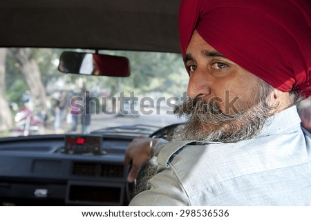 Portrait of a Sikh taxi driver - stock photo