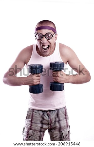 Portrait of a silly nerd in glasses with dumbbell trains - stock photo