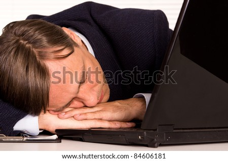 portrait of a sleeping man with computer