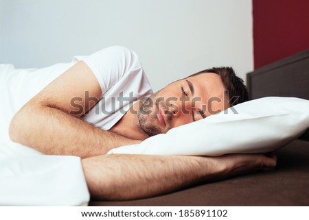 Portrait of a sleeping young man - stock photo