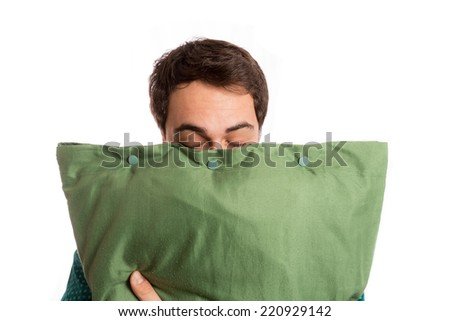 portrait of a sleepyhead man in pajamas with its beloved pillow - stock photo