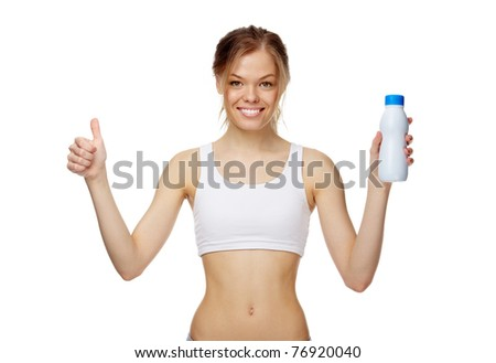 Portrait of a slim girl with a bottle of milk - stock photo