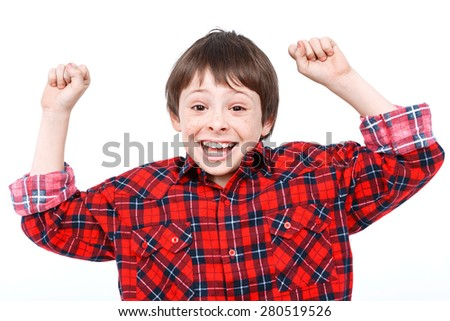 Portrait of a small boy looking very happy holding his hands up and laughing wearing checkered shirt isolated on white background - stock photo