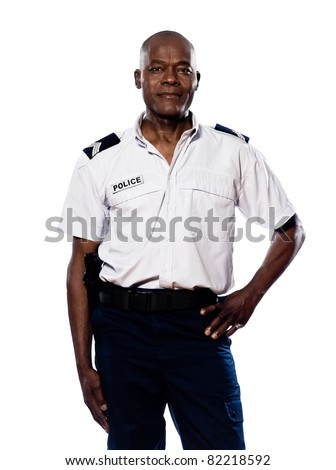 Portrait of a smart afro American policeman smiling with hand on waist in studio on white isolated background - stock photo