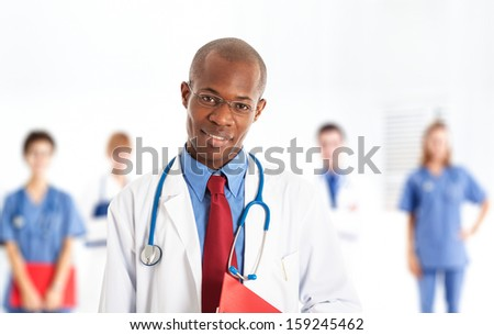 Portrait of a smiling african doctor - stock photo