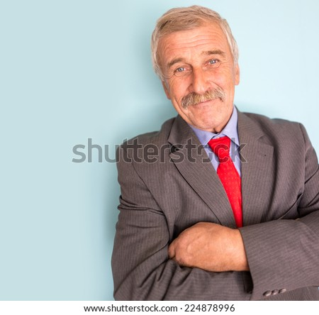 Portrait of a smiling and confident senior good looking business man - stock photo