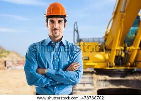 Portrait of a smiling architect in a construction site