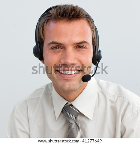 Portrait of a smiling attractive businessman with a headset on - stock photo